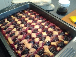Plum cake ready to be glazed with melted jelly