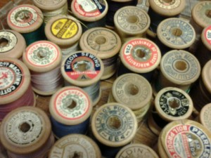 These vintage silk threads on wooden spools are useful sewing resources